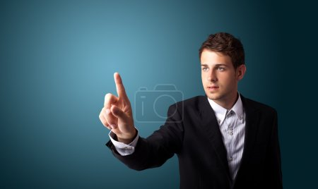 Man pressing an imaginary button on bokeh