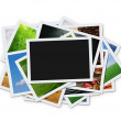Stack of instant photographs isolated on white bac...