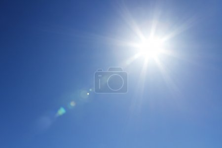 Photo for Sun with bright beams at the clear blue sky with copy space - Royalty Free Image