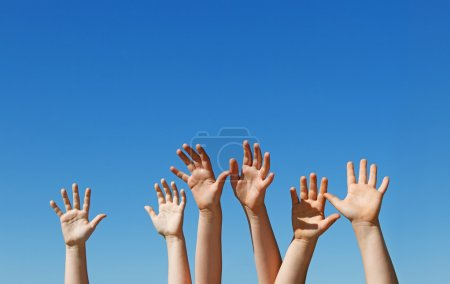 Children hands raised up