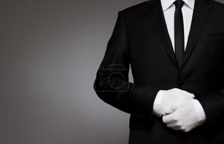 Photo for At Your service. Well dressed man waiting for orders with copy space - Royalty Free Image
