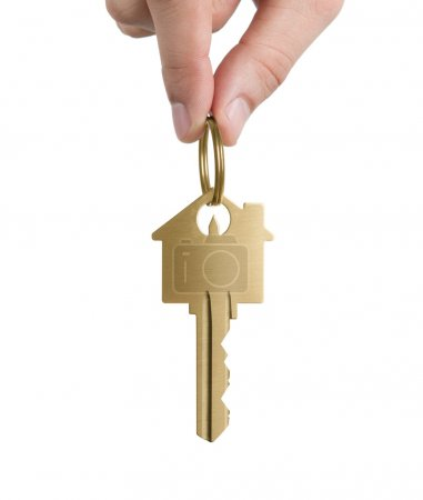 Photo for Human hand holding key to a dream house isolated on white - Royalty Free Image