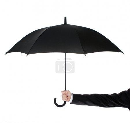 Open umbrella in human hand