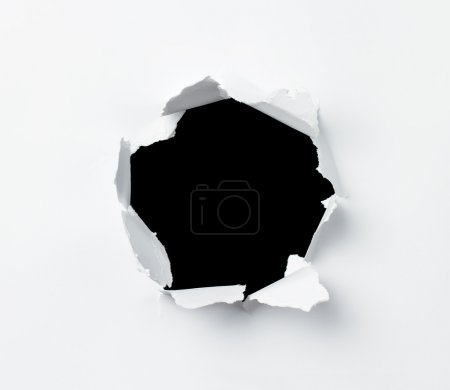 Photo for Hole punched in the paper sheet - Royalty Free Image