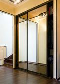 Mirror case in home vestibule