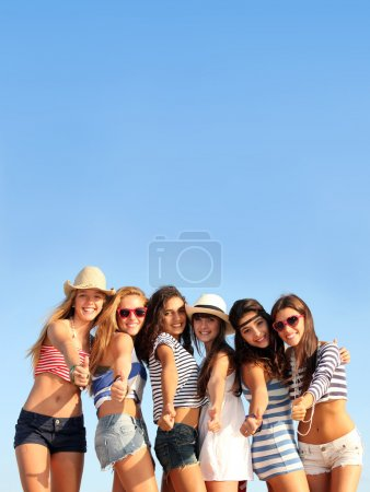 Photo for Group of teens on beach summer vacation or spring break - Royalty Free Image