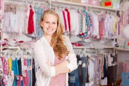 Photo for Woman shopaholic in clothes shop - Royalty Free Image