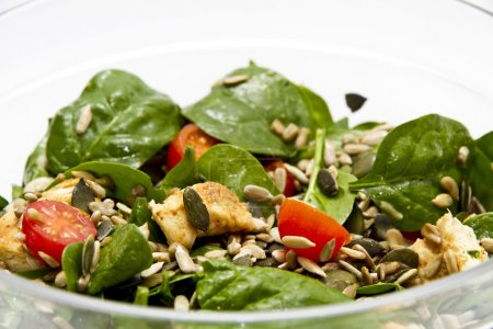 Photo for Spinach salad in transparent bowl - Royalty Free Image