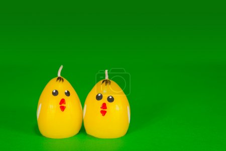 Two yellow chicken candles