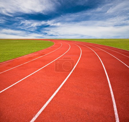 Photo for Running track over blue sky and clouds - Royalty Free Image