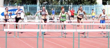 Girls on the 100 meters hurdles race