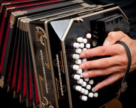 Playing traditional bandoneon.