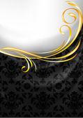 černé textilie opona, zlatý medailónek