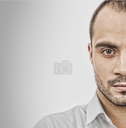 Fashion portrait of adult handsome business man looking at camer