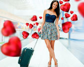 Young woman with luggage at the international airport. She is fl