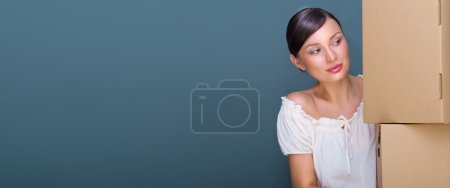 Closeup portrait of a young woman with boxes. Lots of copyspace