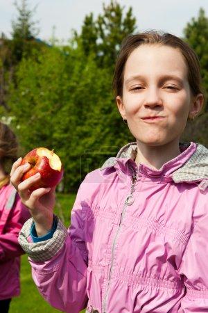 Portrait of happy girl with apple