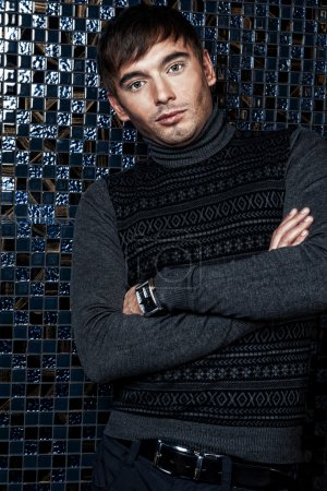Fashion portrait of the young beautiful man inside luxury glamor