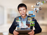 Portrait of young happy man sharing his photo and video files in
