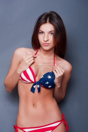 20-25 years old beautiful woman in swimsuit with american flag a