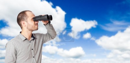 Photo for Business man with binoculars looking to the future or looking for a professional staff - Royalty Free Image