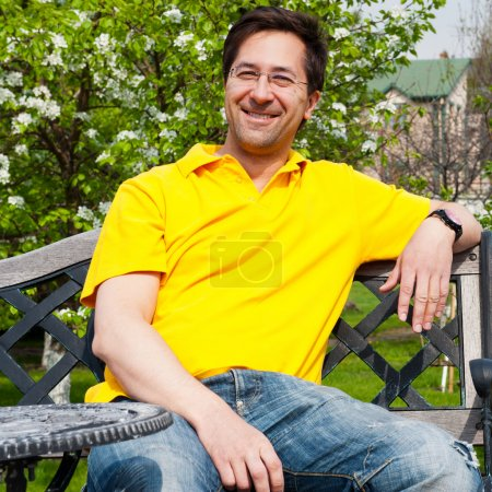 Photo for Middle Aged Man Relaxing In Garden - Royalty Free Image