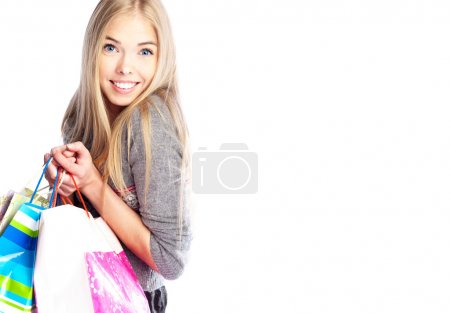 Photo for Portrait of lovely woman with shopping bags over white - Royalty Free Image