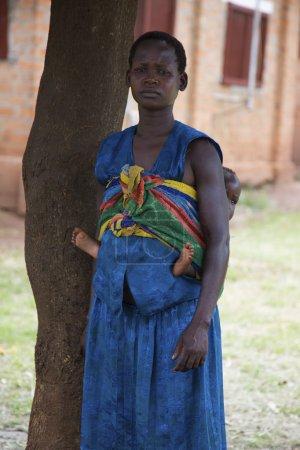 Photo for Lira, Uganda - June 9: Unidentified mother carrying baby in Lira, Uganda on June 9, 2007 - Royalty Free Image