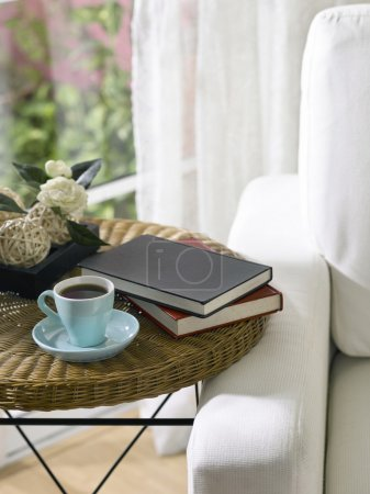 Photo for Tea cup and books on a table. - Royalty Free Image