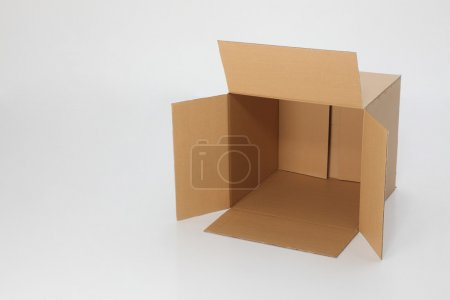 Photo for Empty brown cardbox open on the plain background - Royalty Free Image