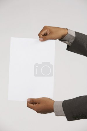 Man holding a white paper as a sign to drop copy