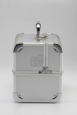 Metal security briefcase in silver on the plain background