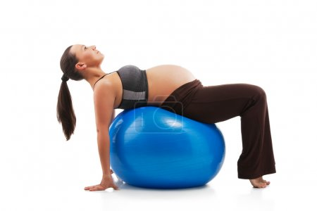 Pregnant woman doing exercises with gim ball, isol...