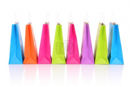Photo for A picture of a row of colorful shopping bags over white background - Royalty Free Image