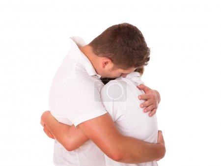 A picture of a young couple hugging over white bac...