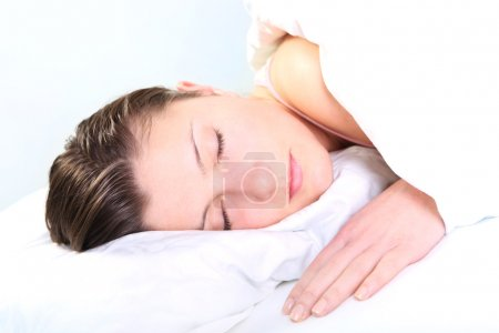 Photo for A picture of a pretty young woman sleeping over white background - Royalty Free Image