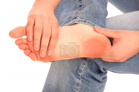 Photo for A picture of female foot in pain over white background - Royalty Free Image