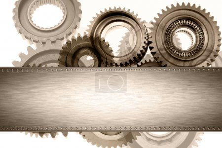Steel panel on cogs. Copy space