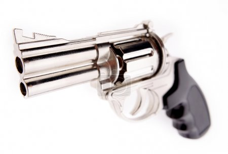 Closeup of handgun on plain background
