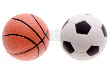 Basketball and football on plain background