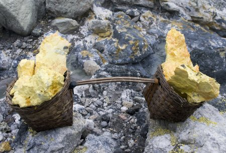 Basket full of sulfur nuggets atop a volcano Ijen ...