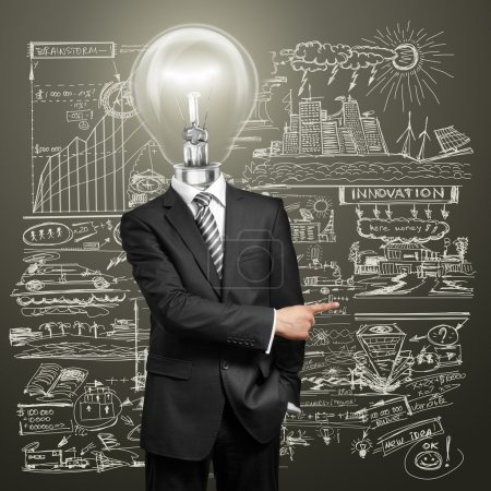 Photo for Lamp head businessman have got an idea and showing with his finger to something - Royalty Free Image
