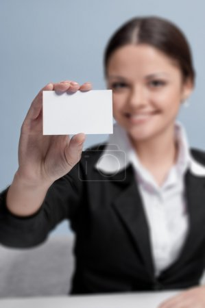 Emotional business woman in office palce show white card