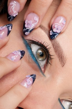 Closeup eyes make-up zone. Nail art