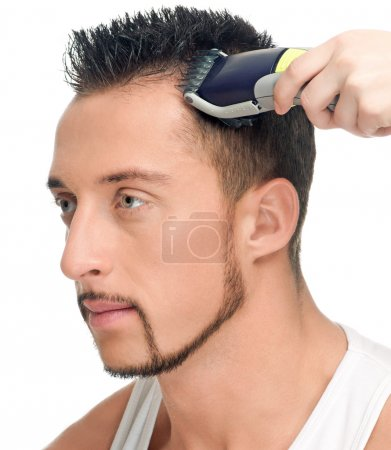 Cutting hairs of attractive man