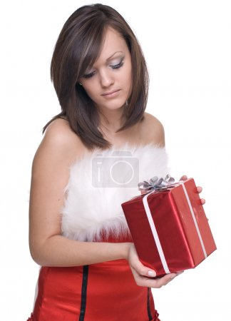 Photo for Emotional playful woman in santa claus dress, white fur and some gifts - Royalty Free Image