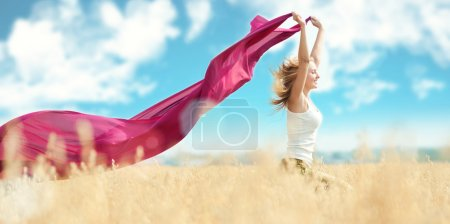 Photo for Young happy woman in wheat field with fabric. Summer picnic - Royalty Free Image