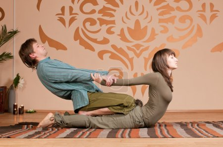 Photo for Two young man and woman couple doing yoga. Massage - Royalty Free Image