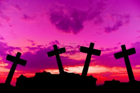 Crosses silhouette at sunset