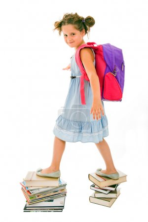 Portrait of litle girl with backpack walking from top to top of